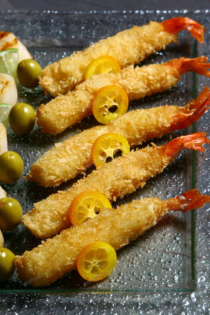 Allsorts from sea combs in orange sauce and crackling tiger shrimps