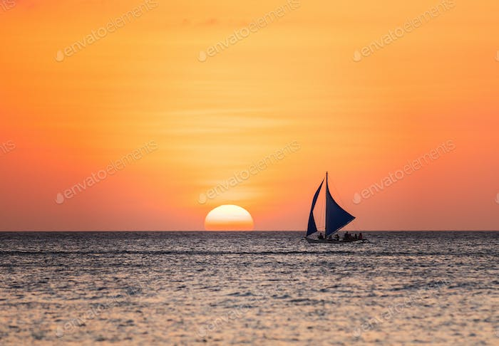 Sunset seascape with a sailboat