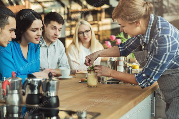Experienced smiling barista giving master class