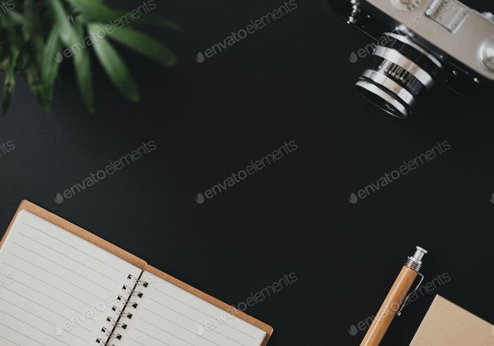 Top view of a flat lay open notebook paper pen