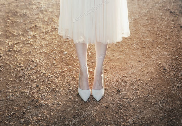 Woman in Heels Standing in the Dirt