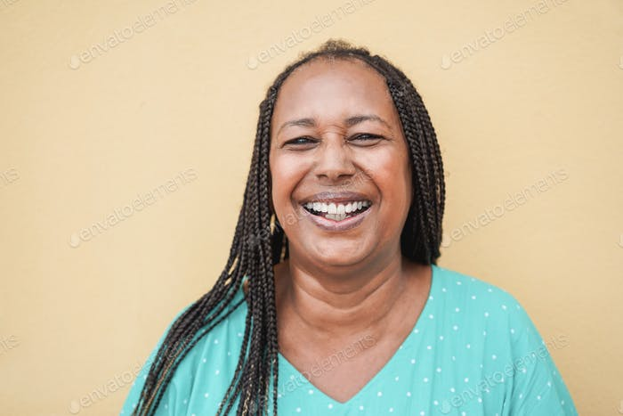 Portrait of happy senior african woman looking at camera - Focus on face
