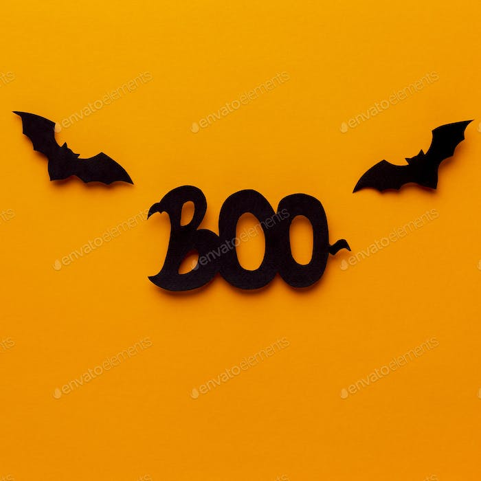 Close up of Boo Halloween text on bright orange background