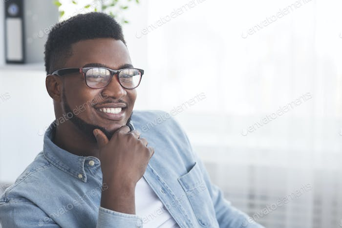 Portrait of handsome smiling african american man in glasses