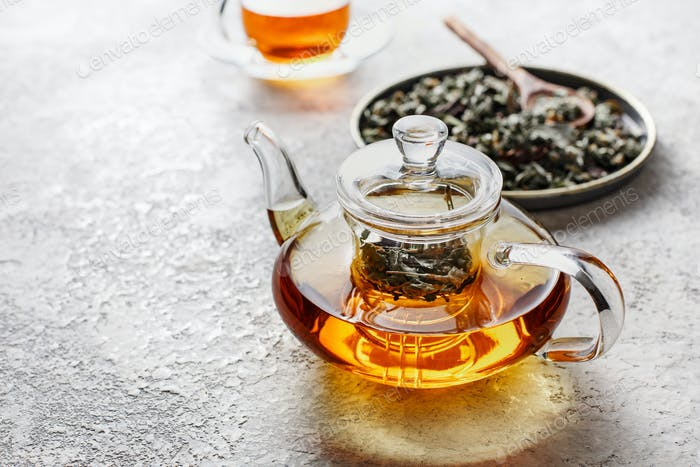 Glass teapot of freshly made herbal tea