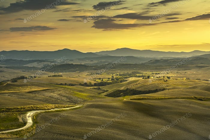 Tuscany spring, rolling hills, rural, road and green fields on s