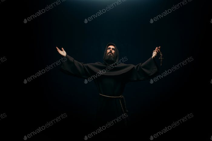 Medieval monk praying to the holy god, religion