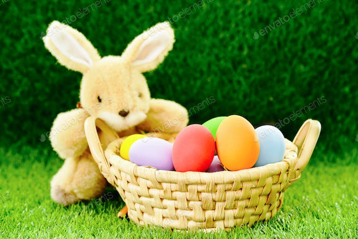 Bunny toy and Easter eggs in basket-2