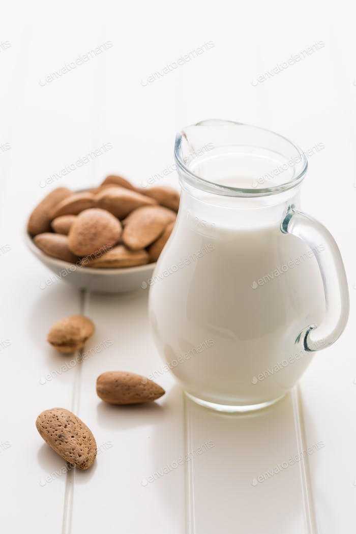 Jar of almond milk with almond nuts