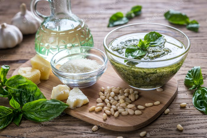 Pesto with ingredients on the wooden table