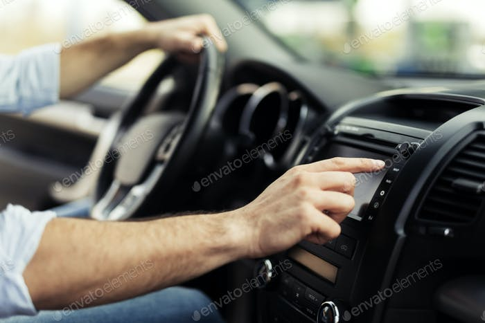 Man Using Gps Navigation System In Car to travel