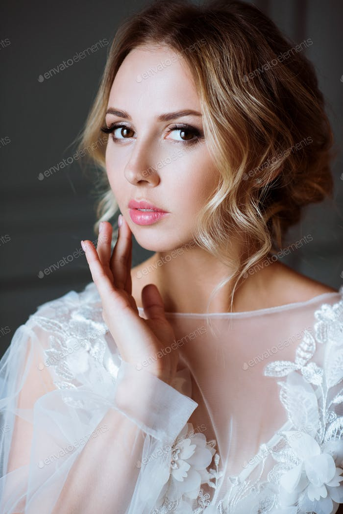 Fashionable female portrait of cute lady in white robe indoors