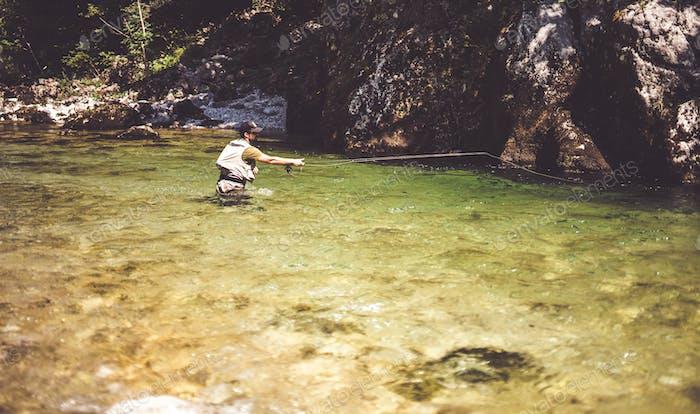 Thumbnail for Fly fisherman flyfishing in river