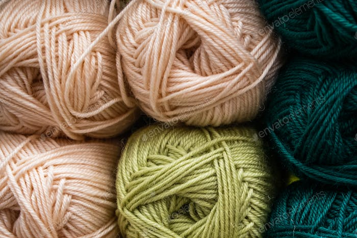 Many balls of wool yarn for knitting. Selling fluffy threads in a craft store