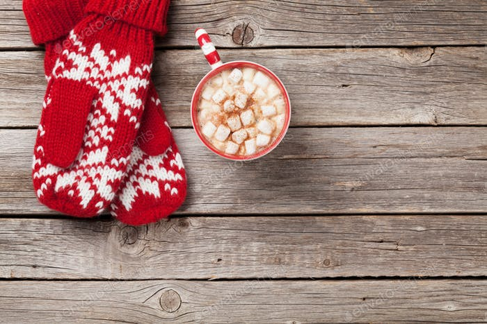 Christmas background with mittens and hot chocolate