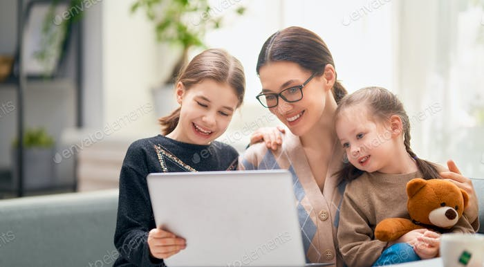 mother and children using a computer