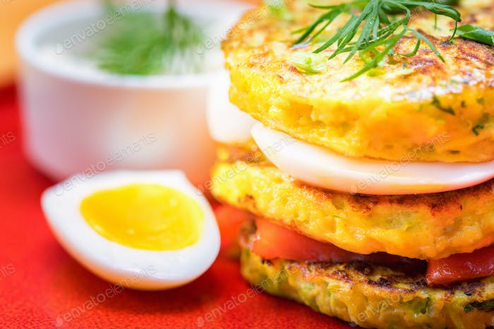 A stack of home-made pancakes with cheese and salmon