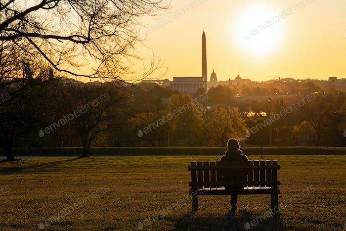 Back side of asian woman sitting alone over the Washington DC Landmark