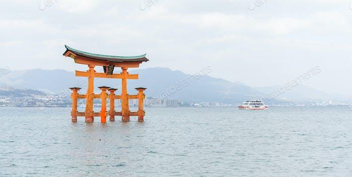 Orange floating Japanese shinto gate in Itsukushima shrine