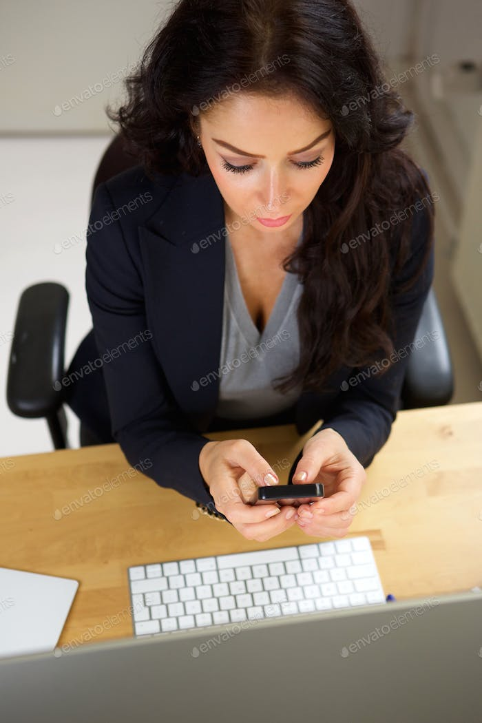 Professional woman sitting with cellphone