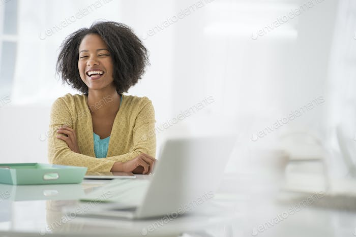 A woman sitting at a desk.