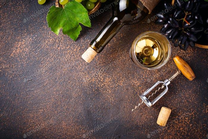 Grape, wine and vintage corkscrew