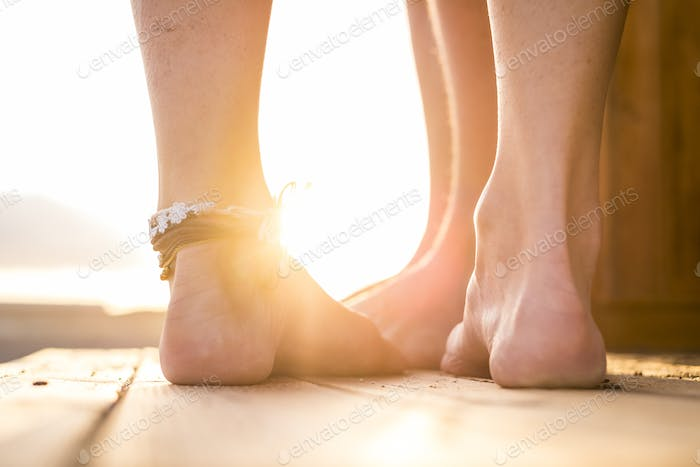 two pair of feet from caucasian man and woman in love