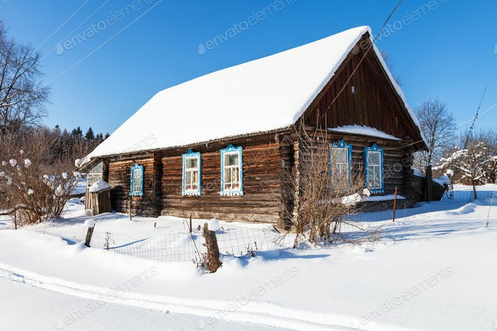 old typical rural house in sunny winter day