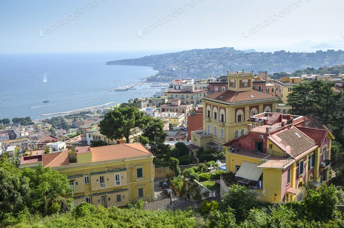 View across the bay of Naples on the coastline of Campania. Historic buildings, and marina and