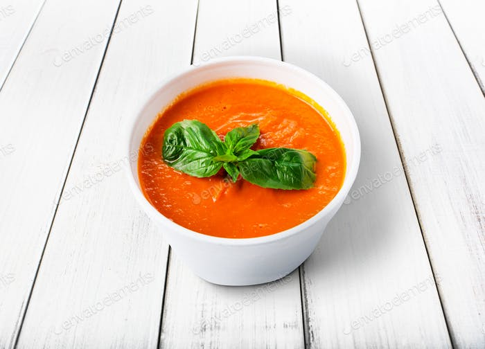 Hot food delivery - tomato gazpacho soup isolated