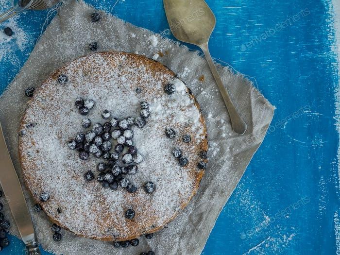 Blueberry pie on blue background