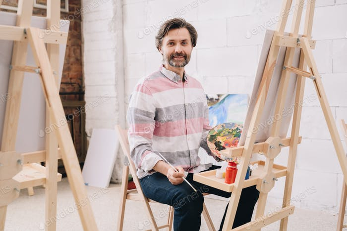 Mature Artist Working in Studio