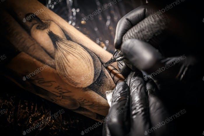 Tattoo master works