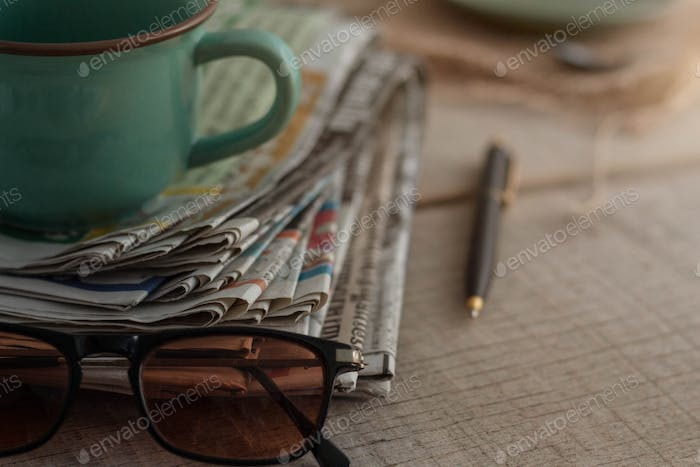Newspapers on wooden boards