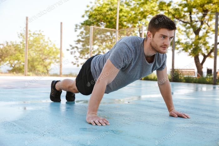 Focused sportsman doing push ups