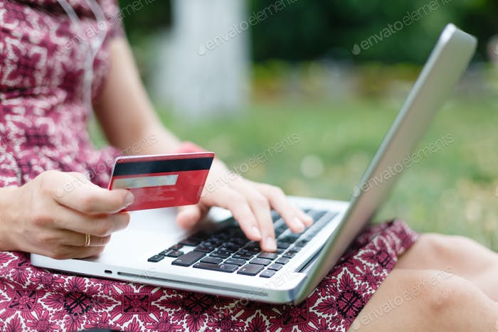 Anonymous woman shopping in Internet
