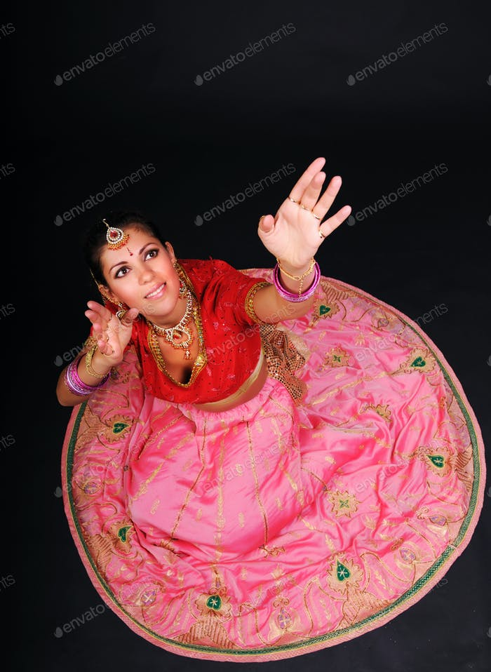 Top view of woman sitting in indian costume