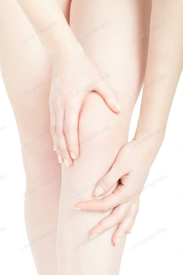 Young woman knee close up with hands isolated on white, clipping