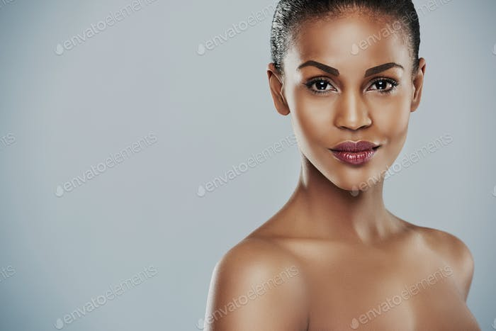 Pretty woman with bare shoulders with copy space