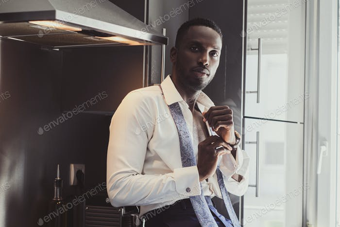 Portrait of elegant businessman at the kitchen