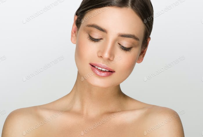 Young woman with beauty skin over gray background