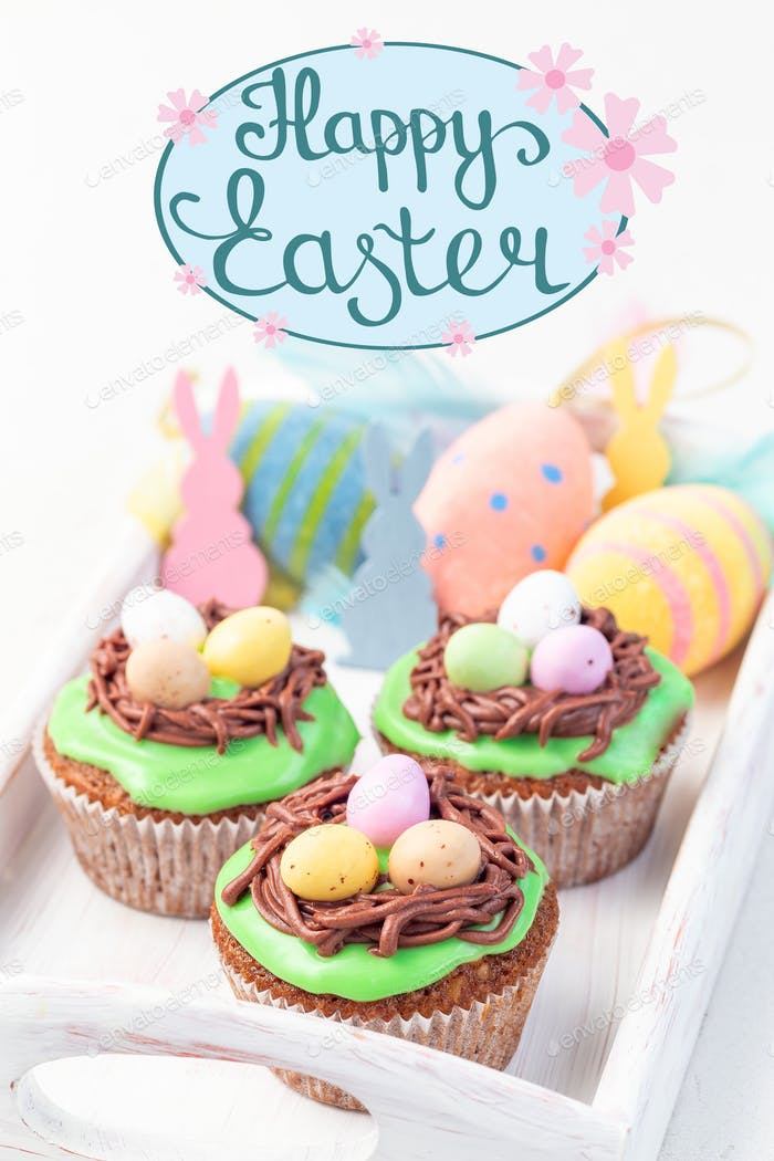 Carrot cake muffins with cream cheese frosting and Easter chocolate eggs, hand drawn lettering