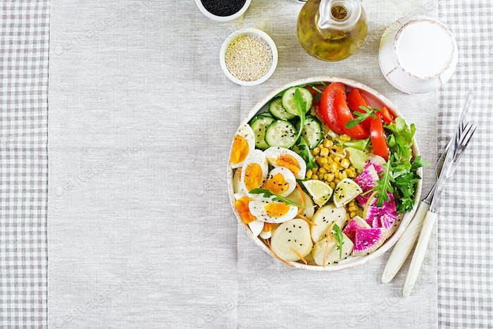 Fresh salad. Vegetarian buddha bowl. Bowl with boiled potato, cu