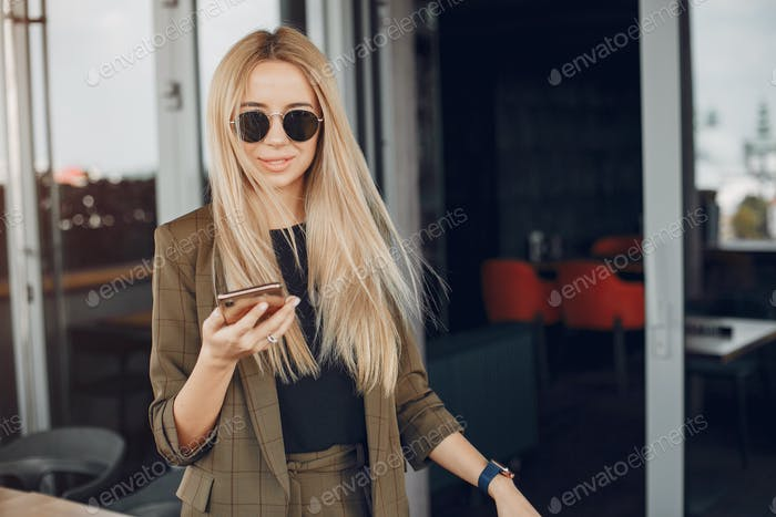 Elegant businesswoman working in a city