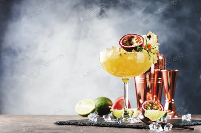 cocktail with syrup, lime, orange juice, soda, ice and passion fruit