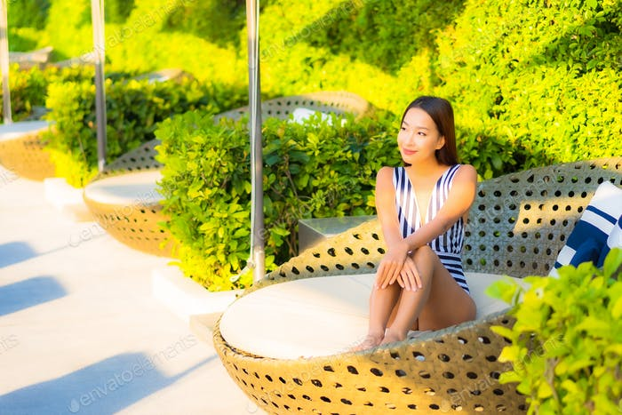 Portrait beautiful young asian woman relax smile leisure on vacation around swimming pool
