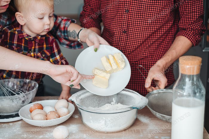 Mom adds butter to flour