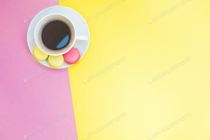 Flat lay of coffee cup with macaroons