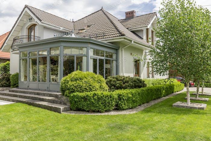 Modern house with glazed arbor