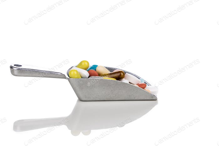 Healthcare concept of ladle with scoop of various medicine tablet, caplets, pills, capsule.